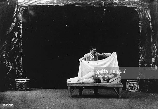 French actor magician designer filmmaker and theatre manager Georges Melies in a film in which he turns a sleeping woman into a butterfly