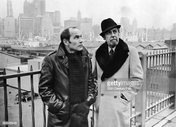 French actor Marcel Bozzuffi and Spanish actor Fernando Rey wait for an accomplice by a pier in Brooklyn in a still from the film 'The French...