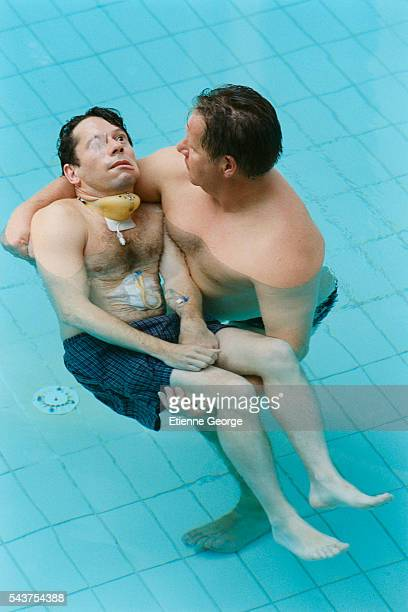 French actor Mathieu Amalric with a physiotherapist on the set of the film Le Scaphandre et le Papillon directed by American artist painter and...