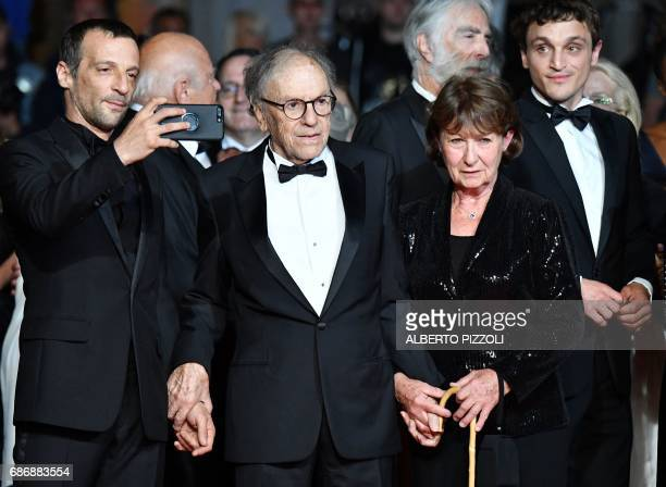 French actor Mathieu Kassovitz takes photos as he arrives on May 22 2017 with French actor JeanLouis Trintignant and his wife Marianne Hoepfner for...