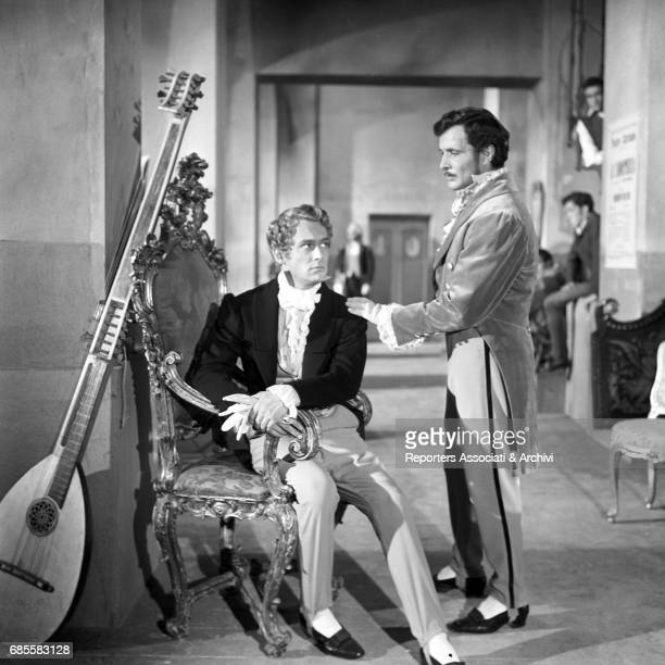 French actor Maurice Ronet he is sitting in an armchair in the role of Vincenzo Bellini meets italian actor Fausto Tozzi in the role of Gaetano...