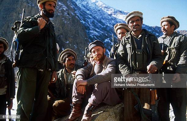 French actor Michel Blanc sits among other actors in Pakistan on the set of the French television movie Medecin des hommes which is based on a true...