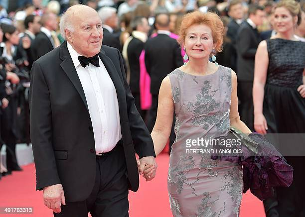 """French actor Michel Piccoli and his wife Ludivine Clerc arrive for the screening of the film """"Saint-Laurent"""" at the 67th edition of the Cannes Film..."""