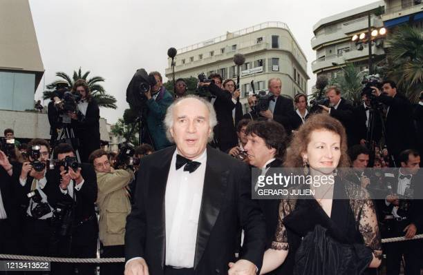 French actor Michel Piccoli and his wife Ludivine Clerc arrive to attend the screening of the film Cliffhanger on May 20 1993 during the evening of...