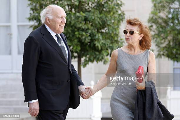 French actor Michel Piccoli and his wife Ludivine Clerc leave the Elysee Palace after a meeting on August 29 2012 in Paris AFP PHOTO PIERRE VERDY