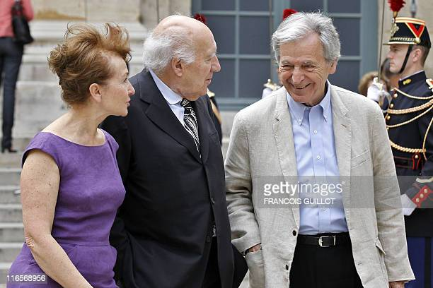 French actor Michel Piccoli and his wife Ludivine Clerc speak with Greek filmmaker CostaGravras as they leave the Institut de France after attending...