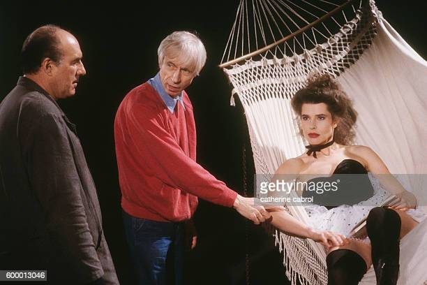 French actor Michel Piccoli director Michel Deville and actress Fanny Ardant on the set of the film Le Paltoquet directed by Deville