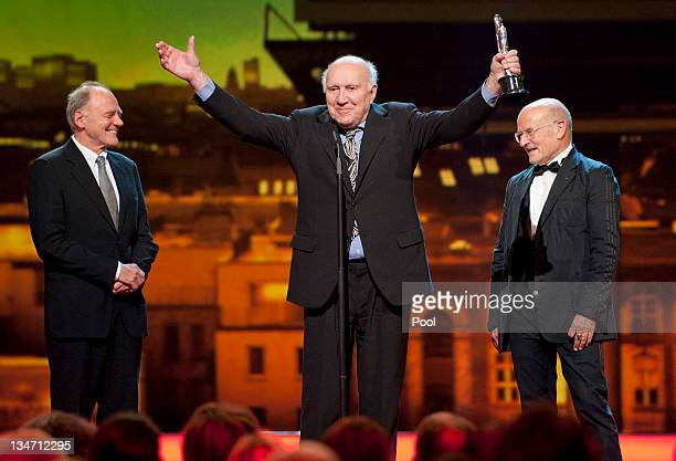 French actor Michel Piccoli holds his honour award next to German director Volker Schloendorff and Swiss actor Bruno Ganz during the 24th European...