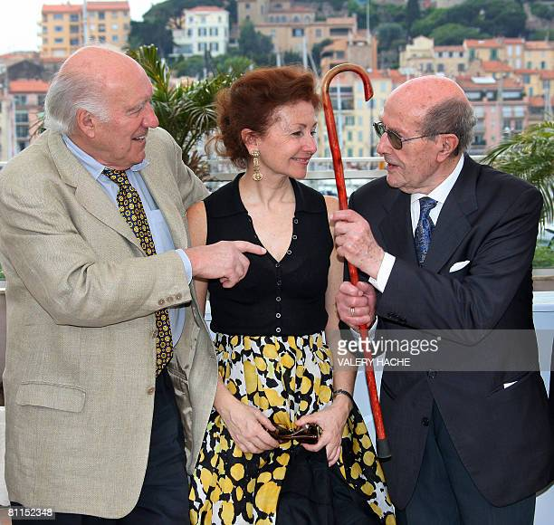 French actor Michel Piccoli jokes with Portuguese director Manoel de Oliveira next to his wife Ludivine Clerc as they pose during a photocall at the...