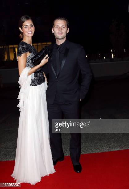 French actor Nicolas Duvauchelle and an unidentified person pose as they arrive to attend the inauguration ceremony of the Cite du cinema a film...
