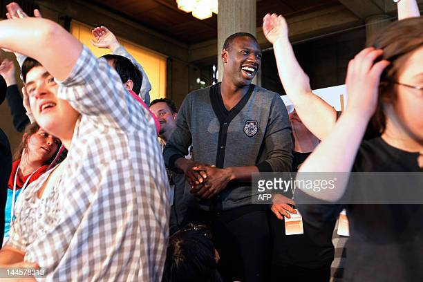 French actor of the French movie Intouchables Omar Sy gives dance lessons to disabled persons on May 16 2012 at the Economic Social and Environmental...