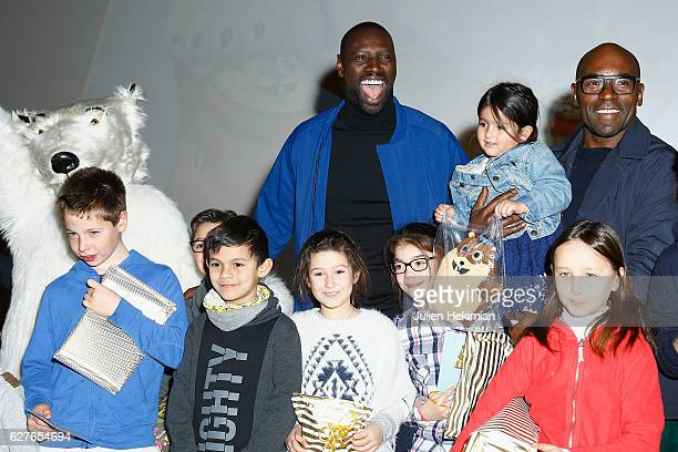 French actor Omar Sy and actor Lucien Jean Baptiste attend 'Norm' Paris Premiere surrounded by kids at Mk2 Bibliotheque on December 4 2016 in Paris...
