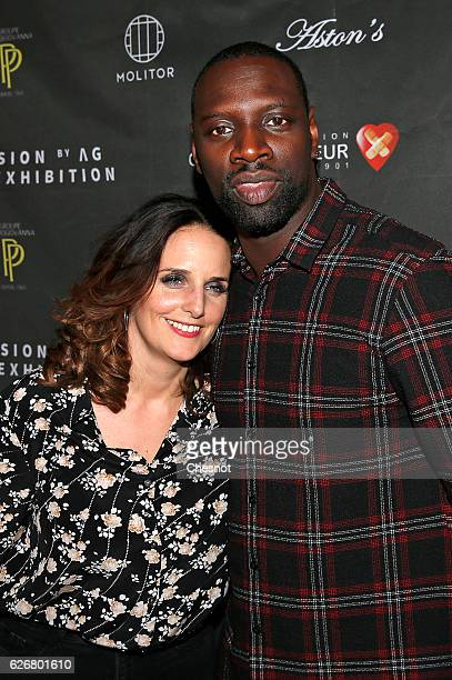 French actor Omar Sy and his wife Helene attend a cocktail party to benefit CeKeDuBonheur at Piscine Molitor on November 30 2016 in Paris France