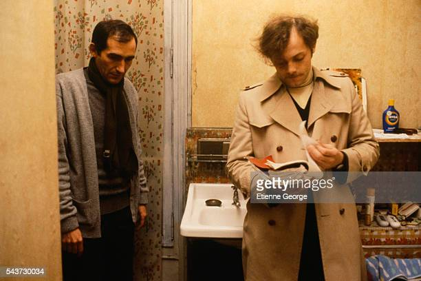 French actor Patrick Dewaere directed by director Alain Corneau on the set of Corneau's film Serie Noire based on American writer Jim Thompson's...
