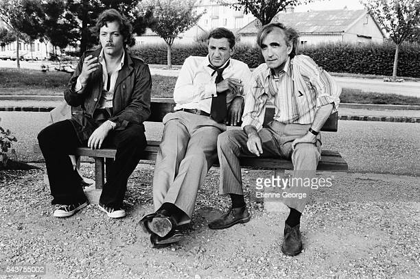 French actor Patrick Dewaere Italianborn actor Lino Ventura and French director Pierre GranierDeferre on set of GranierDeferre's film Adieu Poulet...