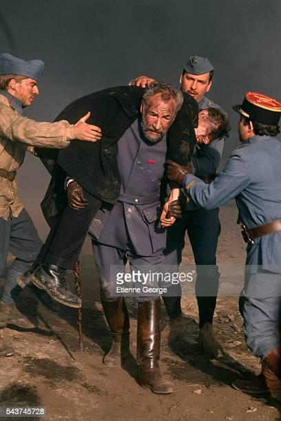 """French actor Philippe Noiret on the set of Bertrand Tavernier's film """"La Vie et rien d'autre"""" , for which Noiret won the 1990 Best Actor Cesar Award."""