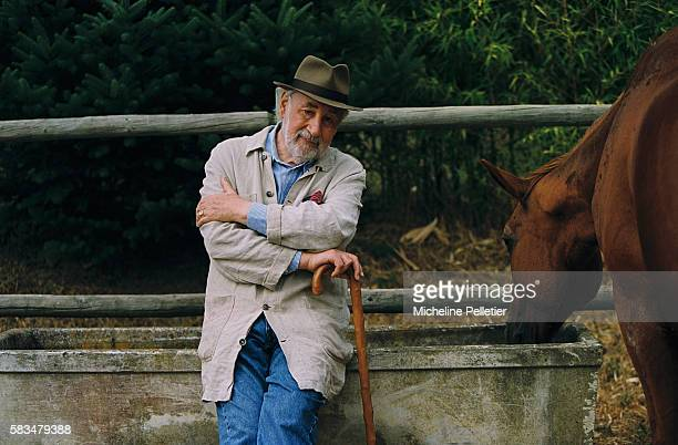 French actor Philippe Noiret relaxes in the French countryside