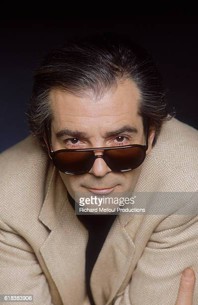 French actor Pierre Arditi looks over the top of his sunglasses