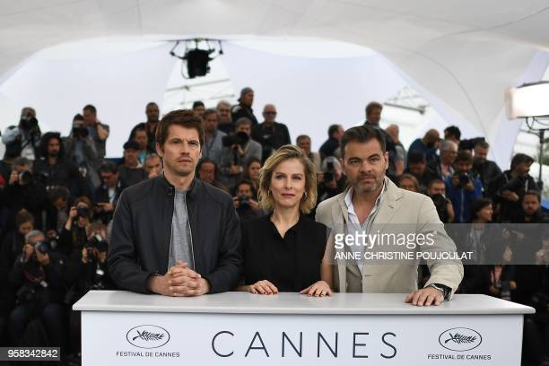 French actor Pierre Deladonchamps, French actress Karin Viard and French actor Clovis Cornillac pose on May 14, 2018 during a photocall for the film...