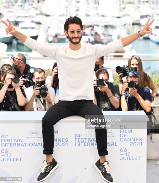 """French actor Pierre Niney poses during a photocall for the film """"OSS 117 : Alerte Rouge en Afrique Noire"""" at the 74th annual Cannes Film Festival in..."""