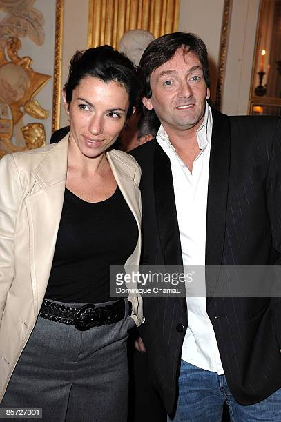 PARIS MARCH 30 French Actor Pierre Palmade and French Actress Aure Atika attend the Medal Ceremonies of French Knight in the Order of Arts and...