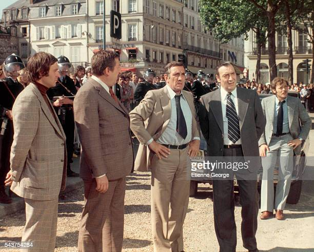 French actor Pierre Tornade Italianborn actor Lino Ventura French actors Julien Guiomar and Patrick Dewaere on the set of Adieu Poulet directed by...
