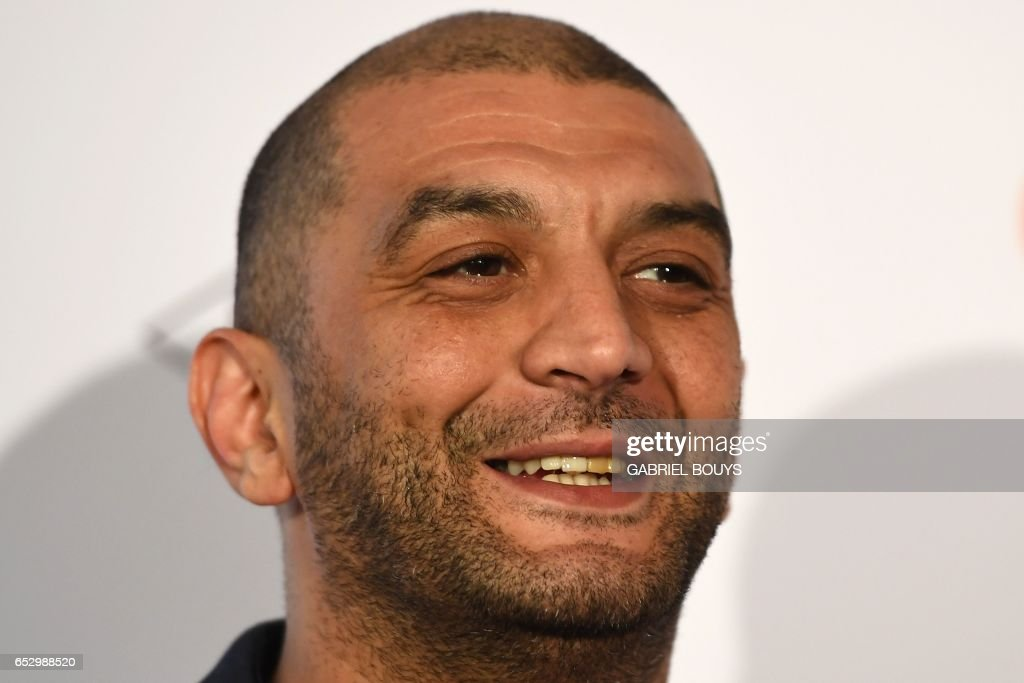French actor Ramzy Bedia poses during the photocall for the premiere of the film 'Chacun Sa Vie' in Paris on March 13, 2017. The film is directed by French director Claude Lelouch. /