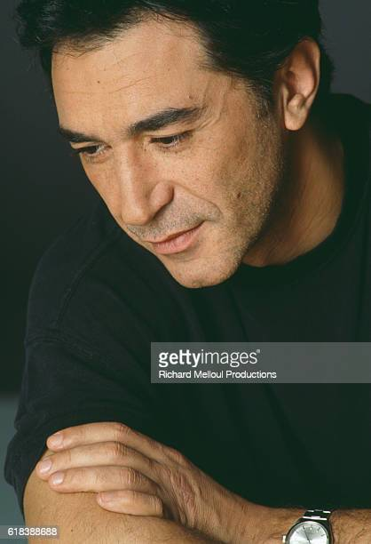 French actor Richard Berry looks down as he poses in Paris