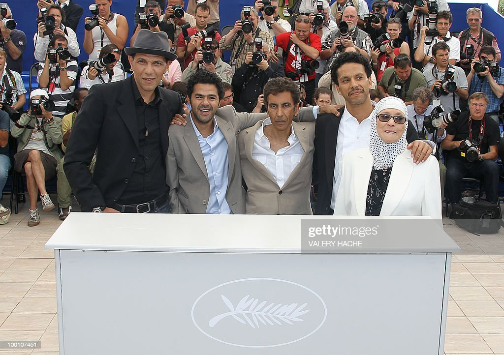 French actor Roschdy Zem, French actor Jamel Debbouze, French director Rachid Bouchareb, French actor Sami Bouajila and actress Chafia Boudraa pose during the photocall of 'Hors La Loi' (Outside of the Law) presented in competition at the 63rd Cannes Film Festival on May 21, 2010 in Cannes.