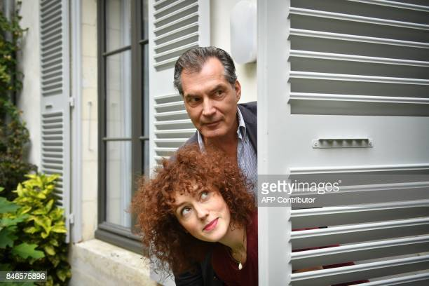 French actor Samuel Labarthe and French actress Blandine Bellavoir pose during the 19th edition of the Festival de fiction TV in La Rochelle western...