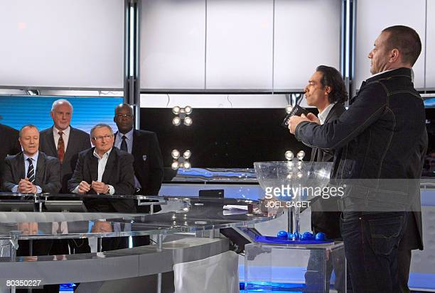 French actor Samuel Le Bihan picks up a Carquefou's card during the draw for the quarterfinals of the French Cup on March 23 2008 in Paris Fifth...
