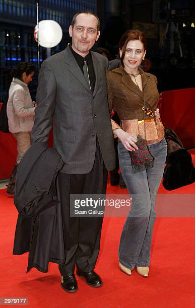 """French actor Serge Renko and Greek actress Katerina Didaskalou arrive for the screening of the French film """"Triple Agent"""" at the 54th annual..."""