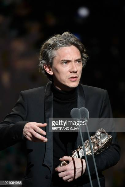 """French actor Swann Arlaud delivers a speech on stage after he won the Best Actor in a Supporting Role award for """"Grace a Dieu """" during the 45th..."""