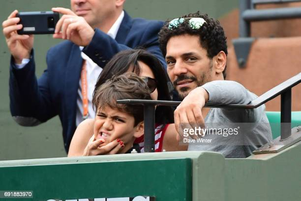 French actor Tomer Sisley with his partner Sandra Zeitoun de Matteis during day 7 of the French Open at Roland Garros on June 3 2017 in Paris France