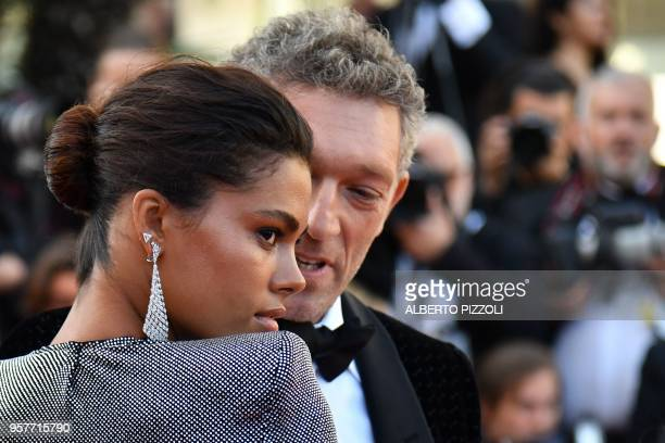 TOPSHOT French actor Vincent Cassel and his partner ItalianTogolese model Tina Kunakey pose as they arrive on May 12 2018 for the screening of the...