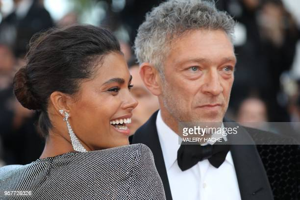 TOPSHOT French actor Vincent Cassel and his partner French model Tina Kunakey pose as they arrive on May 12 2018 for the screening of the film Girls...