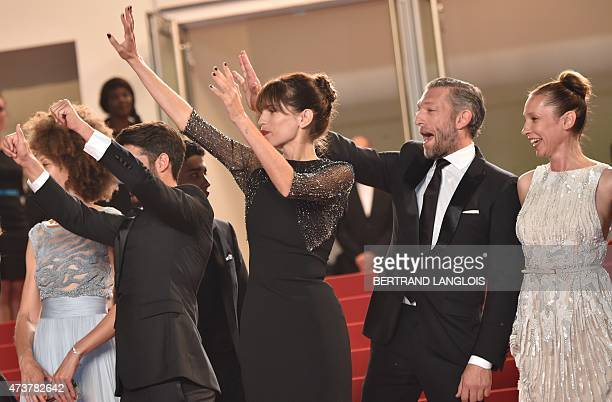 """French actor Vincent Cassel , French actress and director Maiwenn and French actress Emmanuelle Bercot wave as they arrive for the screening of """"Mon..."""