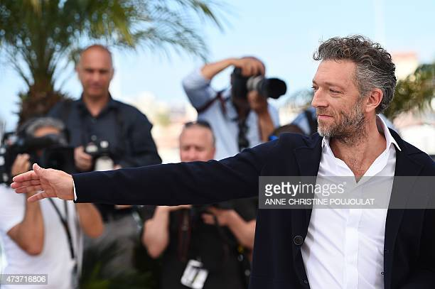 """French actor Vincent Cassel gestures during a photocall for the film """"Mon Roi"""" at the 68th Cannes Film Festival in Cannes, southeastern France, on..."""