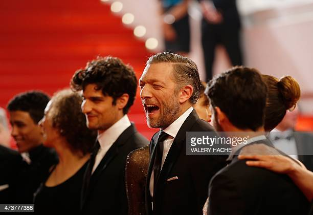 """French actor Vincent Cassel reacts as he arrives for the screening of the film """"Mon Roi"""" at the 68th Cannes Film Festival in Cannes, southeastern..."""