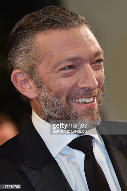 """French actor Vincent Cassel smiles as he arrives for the screening of the film """"Mon Roi"""" at the 68th Cannes Film Festival in Cannes, southeastern..."""