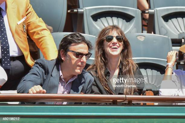 French actor Yvan Attal and his wife Charlote Gainsbourg attend the french open 2014 at Roland Garros on June 6 2014 in Paris France