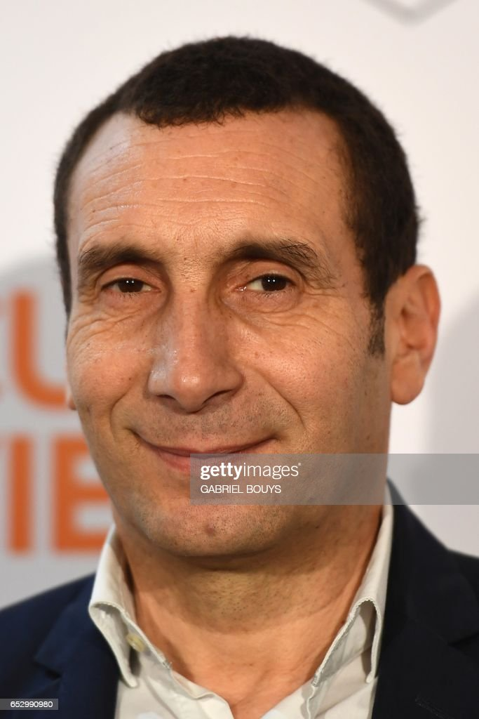 French actor Zinedine Soualem poses during the photocall for the premiere of the film 'Chacun Sa Vie' in Paris on March 13, 2017. The film is directed by French director Claude Lelouch
