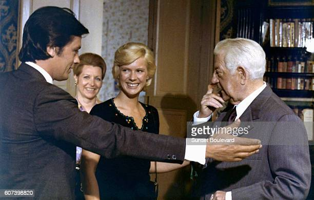 French actors Alain Delon and Jean Gabin and American actress Mimsy Farmer on the set of Deux Hommes dans la Ville written and directed by Jose...