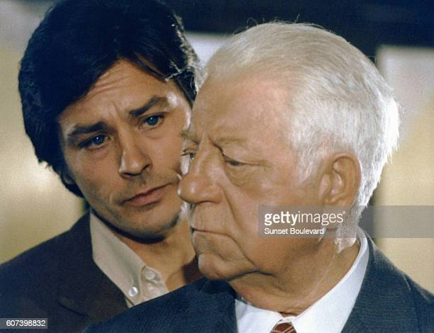 French actors Alain Delon and Jean Gabin on the set of Deux Hommes dans la Ville , written and directed by Jose Giovanni.