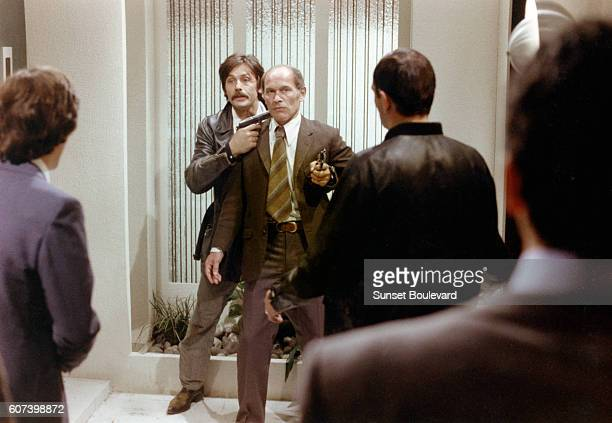 French actors Alain Delon and Marcel Bozzuffi on the set of Le Gitan written and directed by Jose Giovanni