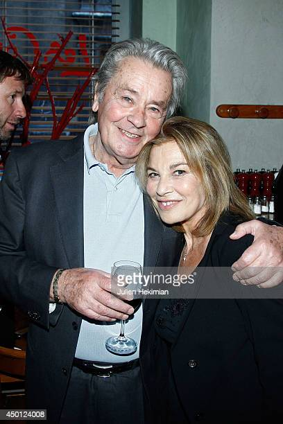 French actors Alain Delon and Nicole Calfan pose after 'Le Mur' Theater Play Premiere on June 5 2014 in Paris France