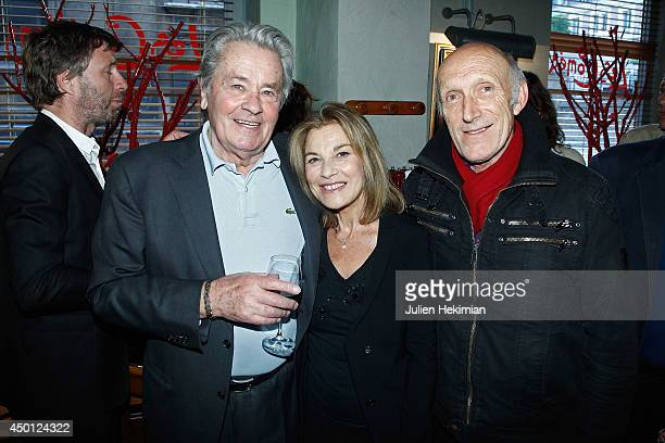 French actors Alain Delon Nicole Calfan and Rufus pose after 'Le Mur' Theater Play Premiere on June 5 2014 in Paris France