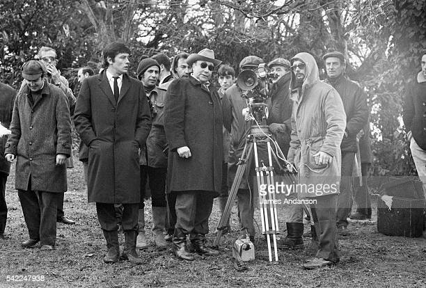 French actors André Bouvil and Alain Delon with director and screenwriter JeanPierre Melville and his crew on the set of his movie Le Cercle Rouge