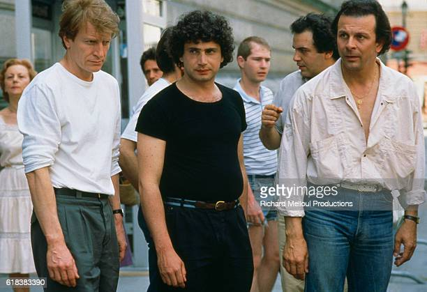 French actors Andre Dussollier Michel Boujenah and Roland Giraud star in the 1985 French film Trois Hommes et un Couffin by French director Coline...