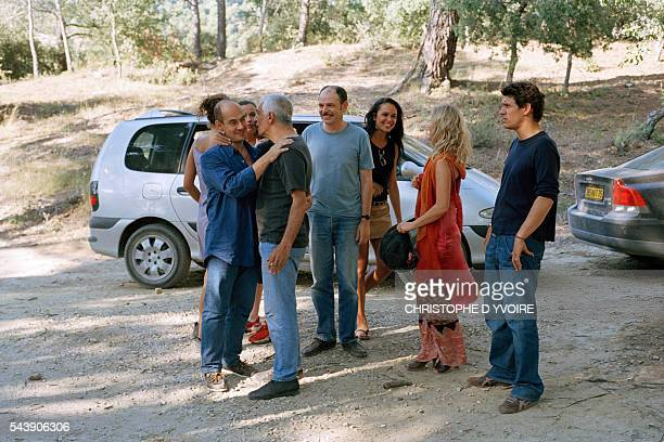 French actors Bernard Campan Gerard Darmon JeanPierre Darroussin Catherine Wilkening Florence Thomassin and Marc Lavoine on the set of the film Le...